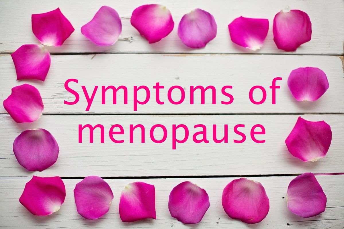 An image with purple-pink rose petals forming a frame and the words 'symptoms of menopause inside the frame.
